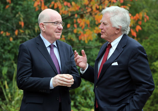 IRISH GOVERMENT ISSUE PICTURE - Irish Foreign Minister, Charlie Flanagan, TD, (left) and US Senator Gary Hart, chat after  their official breakfast meeting in Belfast,ahead of Political talks at Belfast today.Picture Paul Faith