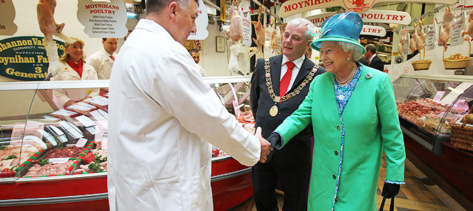 Her Majesty Queen Elizabeth II  meeting trader Jerry Moynihan on a tour of  The Old English Market, Cork City, on her on Friday on her State Visit to Ireland.